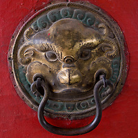 Doorknob at Choijinlam Temple, a rare, remaining Tibetan Buddhist sanctuary in Ulaanbaator, Mongolia.  During the country's Soviet occupation, religion was discouraged and thousands of monks and lamas were executed.  The religion is making a resurgence after independence.