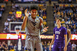 Jan 14, 2020; Morgantown, West Virginia, USA; West Virginia Mountaineers guard Miles McBride (4) celebrates after a play during the second half against the TCU Horned Frogs at WVU Coliseum. Mandatory Credit: Ben Queen-USA TODAY Sports