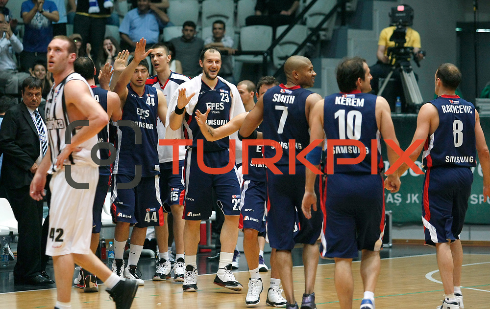 Efes Pilsen's players (Left to Right) Ali ISIK, Dusan CANTEKIN, Ermal KURTOGLU celebrate victory during their Turkish Basketball league Play Off semi final second leg match Besiktas between Efes Pilsen at the BJK Akatlar Arena in Istanbul Turkey on Wednesday 12 May 2010. Photo by Aykut AKICI/TURKPIX