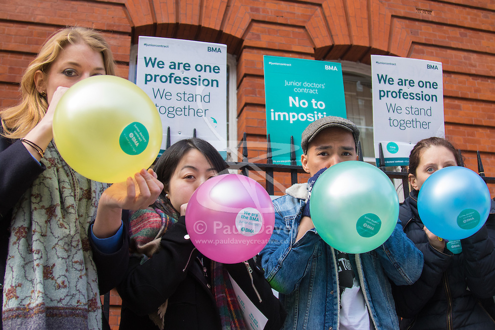Great Ormond Street Hospital, London, April 26th 2016. Medics inflate balloons as striking junior doctors picket outside Great Ormond Street Hospital for Children.