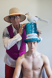 © licensed to London News Pictures. London, UK 14/06/2012. David Shilling posing with a model as he unveils his new collection of hats today (14/06/12). Photo credit: Tolga Akmen/LNP