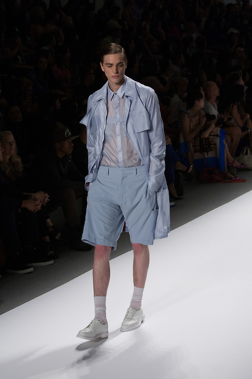 A men's outfit with blue shorts, see-through shirt, and jacket by Richard Chai at the Spring 2013 Mercedes Benz Fashion Week show in New York.