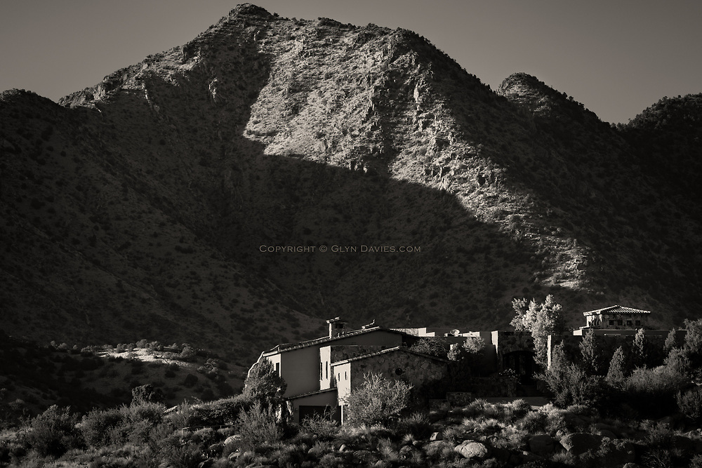 The sun dropped quite quickly in the evenings here, and the Sandia Mountains soon turned to half shadow. A few small houses caught the last of the light in the foothills.