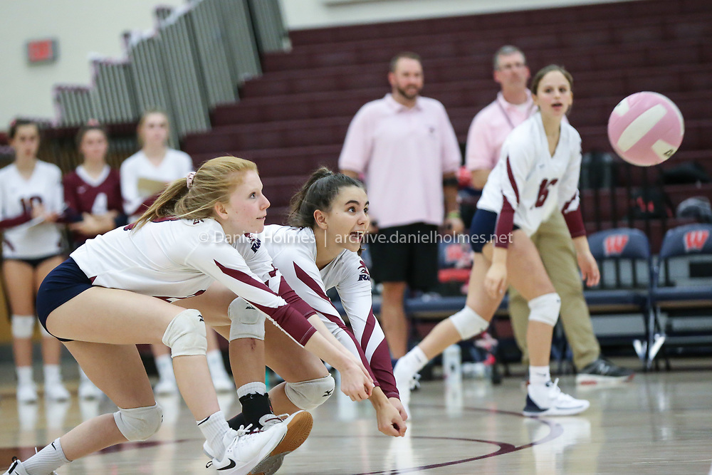 (10/22/19, WESTBOROUGH, MA) Westborough's Jayden Moore, left, and Sarah Cox go for the dig during the annual Dig Pink game against Marlborough at Westborough High School on Tuesday. [Daily News and Wicked Local Photo/Dan Holmes]