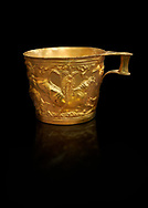 Vapheio type Mycenaean gold cup depicting a wild bull hunt side D, Vapheio Tholos Tomb, Lakonia, Greece. National Archaeological Museum of Athens. Black Background<br /> <br />  Two masterpieces of Creto - Mycenaean gold metalwork were excavated from a tholos tomb near Lakonia in Sparta in 1988. Made in the 15th century BC, the gold cups are heavily influenced by the Minoan style that was predominant in the Agean at the time. The bull hunt was popular with  Mycenaean  and Minoan artists and symolised power and fertility. The distinctive shape of the cup is kown as 'Vapheio type'. .<br /> <br /> If you prefer to buy from our ALAMY PHOTO LIBRARY  Collection visit : https://www.alamy.com/portfolio/paul-williams-funkystock/mycenaean-art-artefacts.html . Type -   Athens    - into the LOWER SEARCH WITHIN GALLERY box. Refine search by adding background colour, place, museum etc<br /> <br /> Visit our MYCENAEN ART PHOTO COLLECTIONS for more photos to download  as wall art prints https://funkystock.photoshelter.com/gallery-collection/Pictures-Images-of-Ancient-Mycenaean-Art-Artefacts-Archaeology-Sites/C0000xRC5WLQcbhQ