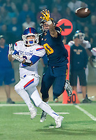 Oak Ridge Trojan Kevin Kassis (10), breaks up a pass intended for Folsom Bulldogs Jack Sa (3), during the second quarter as the Oak Ridge Trojans host the Folsom Bulldogs, Friday October 30, 2015.<br /> Brian Baer/Special to the Bee