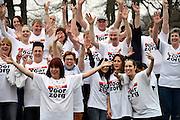 Nederland, Arnhem, 18-03-2014 Bij zorginstelling Vreedenhoff werd dinsdagmiddag een protestactie gehouden. Werknemers onderbreken het werk voor 1 minuut en maken een foto, groepsfoto die ze opsturen aan de vakbond Abva Kabo, FNVFoto: Foto: FLIP FRANSSEN