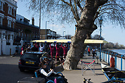 Putney, Great Britain, 17th March 2019,  Pre Boat Race Fixture,  Oxford Brookes University , manoeuvre their boat though the trees and between the parked cars  on Putney Hard, England, [Mandatory Credit; Peter Spurrier/Intersport-images],