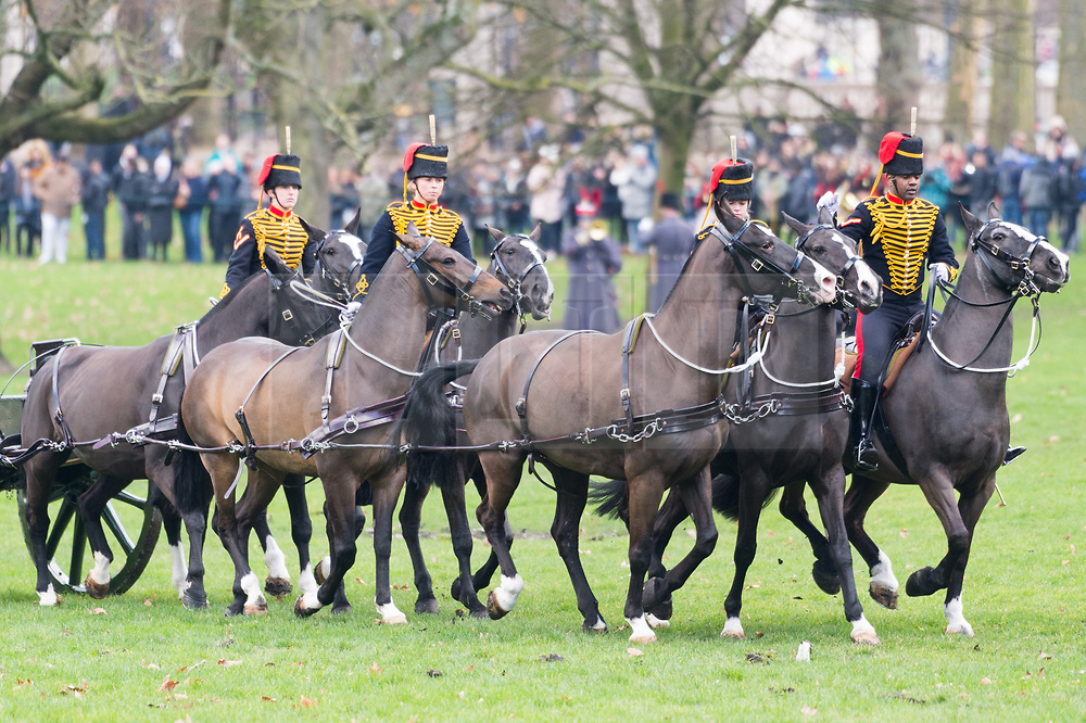 © Licensed to London News Pictures. 06/02/2018. London, UK.The King's Troop Royal Horse Artillery in full dress uniform, ride with horses and gun carriages taking part in a 41 gun salute to mark the anniversary of the Accession of Her Majesty The Queen.  Before their arrival in Green Park, the Band of the Royal Artillery play a selection of celebratory music close to the firing position. 71 horses pulling six First World War-era 13-pounder field guns will then dramatically come into action from the North of the Park to place the guns into position for the Royal Salute.Photo credit: Ray Tang/LNP