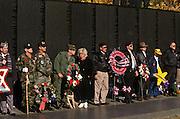 Vietnam veterans attend a Veterans Day ceremony at the Vietnam Veterans Memorial November 11, 1996 in Washington, DC.