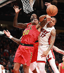January 6, 2019 - Atlanta, GA, USA - Miami Heat guard Rodney McGruder blocks a shot by Atlanta Hawks forward John Collins during the first half on Sunday, Jan. 6, 2019 at State Farm Arena in Atlanta, Ga. (Credit Image: © Curtis Compton/Atlanta Journal-Constitution/TNS via ZUMA Wire)