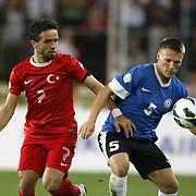 Turkey's Gokhan Gonul (L) and Estonia's Dmitri KRUGLOV  during their FIFA World Cup 2014 qualifying soccer match Turkey betwen Estonia at Sukru Saracoglu stadium in Istanbul September 11, 2012. Photo by TURKPIX