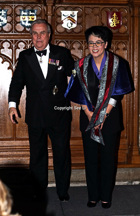 London,England,UK. 31th March 2017: Lord David Brewer presents Jin Shu Hui winner of the awards of the Master of the Art of Directing at the Athene Festival 2017 at Guildhall,London,UK. by See Li