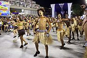 Men dressed as cavemen dancing for Salgueiro Samba School doing the final practice performance of their Carnival procession in the Sambadrome, Rio de Janeiro, Brazil