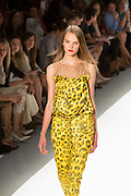 Yellow and black jungle print pants suit. By Carlos Miele at the Spring 2013 Mercedes-Benz Fashion Week in New York.