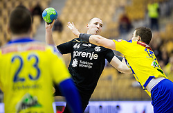 Mitja Nosan of RK Gorenje vs Vid Poteko of RK Celje PL during handball match between RK Celje Pivovarna Lasko and RK Gorenje Velenje in Eighth Final Round of Slovenian Cup 2015/16, on December 10, 2015 in Arena Zlatorog, Celje, Slovenia. Photo by Vid Ponikvar / Sportida