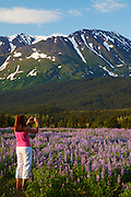 Visitor taking a photo with an iphone, Chugach National Forest, Alaska.  (model released)