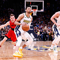 09 April 2018: Denver Nuggets guard Jamal Murray (27) eyes the basket past Portland Trail Blazers guard Pat Connaughton (5) next to Denver Nuggets center Mason Plumlee (24) during the Denver Nuggets 88-82 victory over the Portland Trail Blazers, at the Pepsi Center, Denver, Colorado, USA.