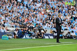 Manchester City Manager, Manuel Pellegrini - Photo mandatory by-line: Dougie Allward/JMP - Tel: Mobile: 07966 386802 22/09/2013 - SPORT - FOOTBALL - City of Manchester Stadium - Manchester - Manchester City V Manchester United - Barclays Premier League