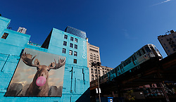 A mural on a side of a building in the Wabash art corridor as a CTA train goes by