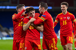CARDIFF, WALES - Wednesday, November 18, 2020: Wales' Daniel James (C) celebrates after scoring the second goal during the UEFA Nations League Group Stage League B Group 4 match between Wales and Finland at the Cardiff City Stadium. Wales won 3-1 and finished top of Group 4, winning promotion to League A. (Pic by David Rawcliffe/Propaganda)