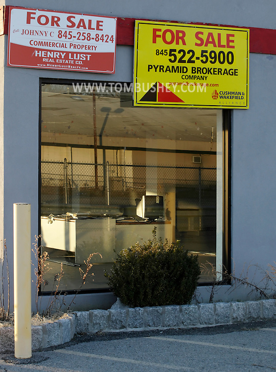 New Hampton, New York - A computer monitor sits on a desk in a vacant building, formerly a car dealership, with for sale signs on March 19, 2011.