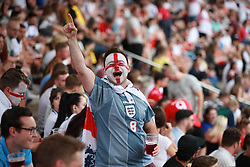 © Licensed to London News Pictures . 11/07/2018. Manchester, UK. Football fans gather to watch England play against Croatia in the World Cup semi finals, on a big screen at Castlefield Bowl in Manchester City Centre . Until today , Manchester had been the largest city in England not to be showing World Cup matches to the public on a big screen . Photo credit: Joel Goodman/LNP