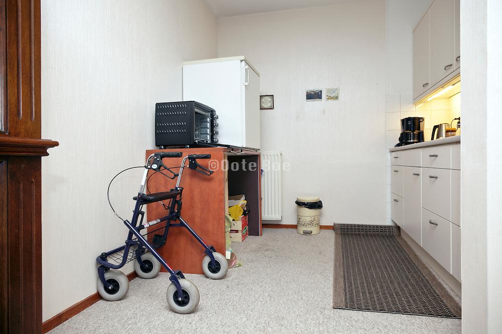 walker in kitchen of a senior independent living home