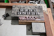 Lead type on a workbench.