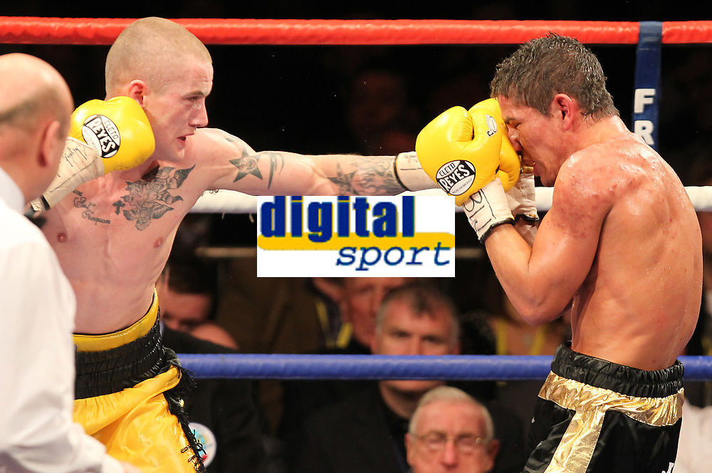 Boxing - WBO Super-featherweight World Title - Ricky Burns vs. Andreas Evensen<br /> <br /> <br /> Ricky Burns (shaved head) and Andreas Evensen in action during the  Boxing - WBO Superfeatherweight World Title between Ricky Burns vs. Andreas Evensen at Braehead Arena.