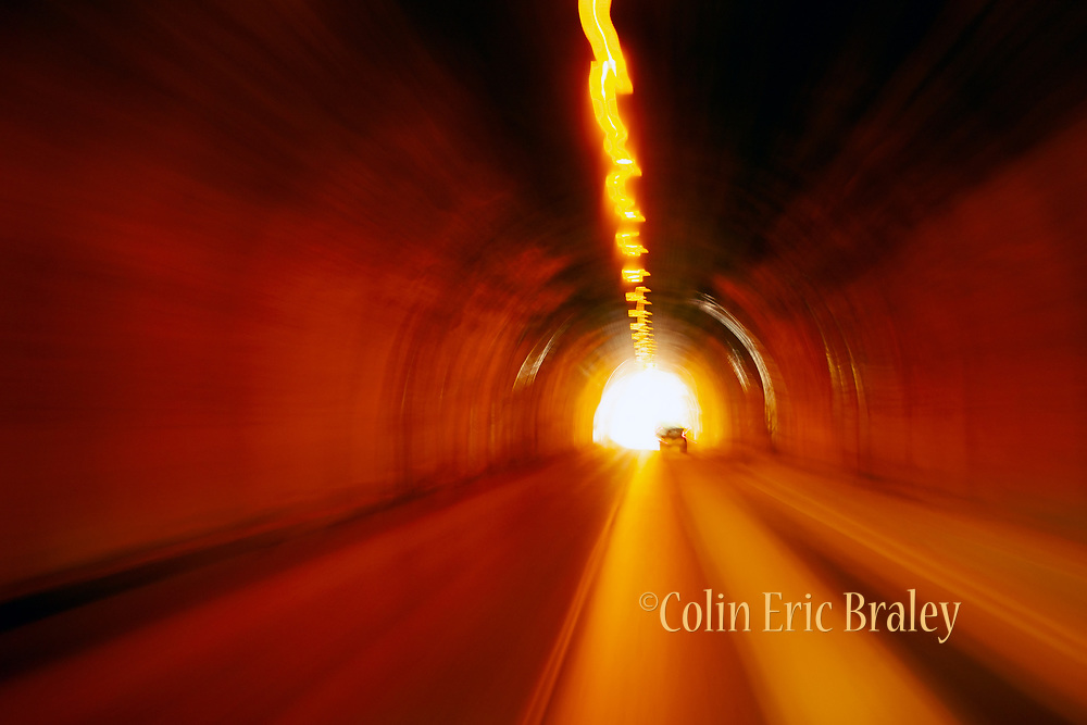 Abstract Wall Art Photography For Sale- A road tunnel shot at a slow shudder speed on the way to Yosemite National Park. Photo by Colin Braley
