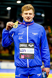 Adam Peaty of Great Britain poses with his Gold medal after winning the Mens 50m Breaststroke Final after setting a new World Recored in the previous day's Semi-Final - Photo mandatory by-line: Rogan Thomson/JMP - 07966 386802 - 23/08/2014 - SPORT - SWIMMING - Berlin, Germany - Velodrom im Europa-Sportpark - 32nd LEN European Swimming Championships 2014 - Day 11.