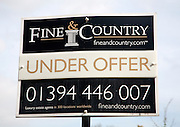 Fine and Country estate agent Under Offer sign close-up, Suffolk, England