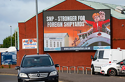Port Glasgow, Scotland, UK. 21st September 2021. Pro UK Union group Scotland Matters has erected a billboard outside the Ferguson Shipyard in Port Glasgow critical of the Scottish Government's decision to place orders for future Scottish ferries with one a short list of three yards, in Turkey, Poland or Romania. The billboard features SNP leader and First Minister Nicola Sturgeon and former First Minister Alex Salmond  standing on the bow of the Titanic liner with message SNP Stronger for Foreign Shipyards.  Iain Masterton/Alamy Live News.