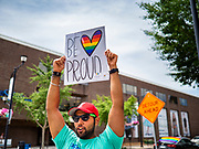 """28 JUNE 2020 - DES MOINES, IOWA: NAREN BHOJWANI cheers during the Capitol City Pride Parade in Des Moines. Most of the Pride Month events in Des Moines were cancelled this year because of the COVID-19 pandemic, but members of the Des Moines LGBTQI community, and Capitol City Pride, the organization that coordinates Pride Month events, organized a community """"parade"""" of people driving through the East Village of Des Moines displaying gay pride banners and flags. About 75 cars participated in the parade.    PHOTO BY JACK KURTZ"""