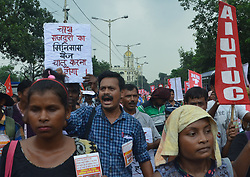 August 3, 2017 - Kolkata, West Bengal, India - There was a rally conducted on the Rajpath, Kolkata today by tea workers on N Bengal, demanding raise in their minimum wages, safety in work place, assurance of job and food safety. (Credit Image: © Sandip Saha/Pacific Press via ZUMA Wire)