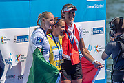 Lucerne, SWITZERLAND, 15th July 2018, Sunday Women's Single Sculls, Medal Ceremony,  Pontoon, centre,  Gold Medalist, SUI W1X,  Jeannine GMELIN, left, Silver Medalist, IRL W1X, Sanita PUSPURE and right, Bronze Medalist, CAN W1X, Carling ZEEMAN, FISA World Cup III Lake Rotsee, © Peter SPURRIER,