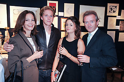 Left to right, MRS KEVIN BENTLEY, MR HAMISH KHAYAT, KINVARA BENTLEY and MR KEVIN BENTLEY at an auction and priavte view of paintings, drawings, stories and doodles by well known personalities held at Christie's, St.James's, London on 20th September 2010.