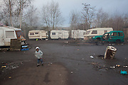 A little boy is playing in a gypsy settlement on the outskirts on Lille. // France is the land of destination of many Roma people in their diaspora across Europe, who live camped in many settlements at the outskirts of cities. In 2013, the French Government has expelled thousands of Gypsies from the East as in 2010, 2011 and 2012, this time without any financial aids. Many Roma live afraid to be expelled but they remain in the French country with the hope of receiving some kind of aid. Outskirts of Lille, France. December 2013. is playing in a gypsy settlement on the outskirts on Lille. // France is the land of destination of many Roma people in their diaspora across Europe, who live camped in many settlements at the outskirts of cities. In 2013, the French Government has expelled thousands of Gypsies from the East as in 2010, 2011 and 2012, this time without any financial aids. Many Roma live afraid to be expelled but they remain in the French country with the hope of receiving some kind of aid. Outskirts of Lille, France. December 2013.