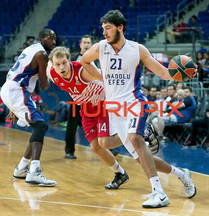 Anadolu Efes's Okben Ulubay (R) during their Gloria Cup Basketball Tournament match Anadolu Efes between Crvena Zvezda at Ulker Sports Arena in istanbul Turkey on Friday 26 September 2014. Photo by Aykut AKICI/TURKPIX