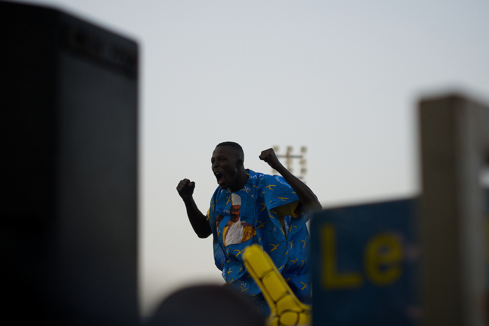 February 22, 2012 - Dakar, Senegal: A man reacts during a campaign rally for president Abdoulaye Wade in Pykine, a suburb of the capital Dakar, ahead of the presidential elections on the 26th of February.  (Paulo Nunes dos Santos/Polaris)