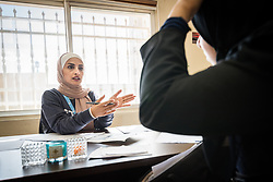 16 February 2020, Irbid, Jordan: Referral officer Manal Ali Al-Husban receives a Syrian refugee at the Lutheran World Federation community centre in Irbid. The centre offers psychosocial support to Syrian refugees in Jordan.
