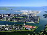Nederland, Noord-Holland, Amsterdam, 02-09-2020; IJburg, Haveneiland met Rieteiland-Oost in de voorgrond. in het water van de IJburgbaai en IJmeer Centrumeiland, met Middeneiland en Strandeiland in staat van wording.<br /> IJburg, Haveneiland with Rieteiland-East in the foreground. in the waters of the IJburgbaai and IJmeer Center Island, with Middeneiland and Strandeiland in statu nascendi.<br /> <br /> luchtfoto (toeslag op standard tarieven);<br /> aerial photo (additional fee required);<br /> copyright foto/photo Siebe Swart
