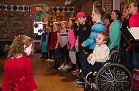 Mr. Anderson's 4th grade chorus from Gilford Elementary School performs a series of pirate songs during Arts Alive opening night at the Belknap Mill on Thursday evening.   (Karen Bobotas/for the Laconia Daily Sun)