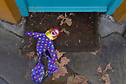 A dropped child's toy puppet lies on the ground outside a high street shop in East Dulwich, on 25th December 2020, in London, England.