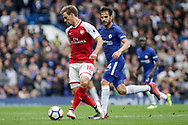Nacho Montreal of Arsenal plays a pass under pressure from Cesc Fabregas of Chelsea. Premier league match, Chelsea v Arsenal at Stamford Bridge in London on Sunday 17th September 2017.<br /> pic by Kieran Clarke, Andrew Orchard sports photography.