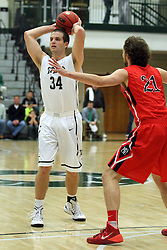 25 November 2014:  Ryan Coyle during an NCAA mens division 3 CCIW basketball game between the Milwaukee School of Engineering Raiders and the Illinois Wesleyan Titans in Shirk Center, Bloomington IL
