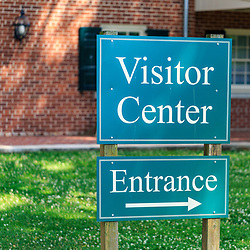 Lancaster, PA, USA - July 12, 2016: A Visitor Center and Entrance directional sign.