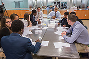 Purchase, NY – 31 October 2014. Rashad Bilal, in the blue shirt at the end of the table, talking to his team from Woodlands High School. Woodlands High School went on to place second in the 2014 competition. The Business Skills Olympics was founded by the African American Men of Westchester, is sponsored and facilitated by Morgan Stanley, and is open to high school teams in Westchester County.