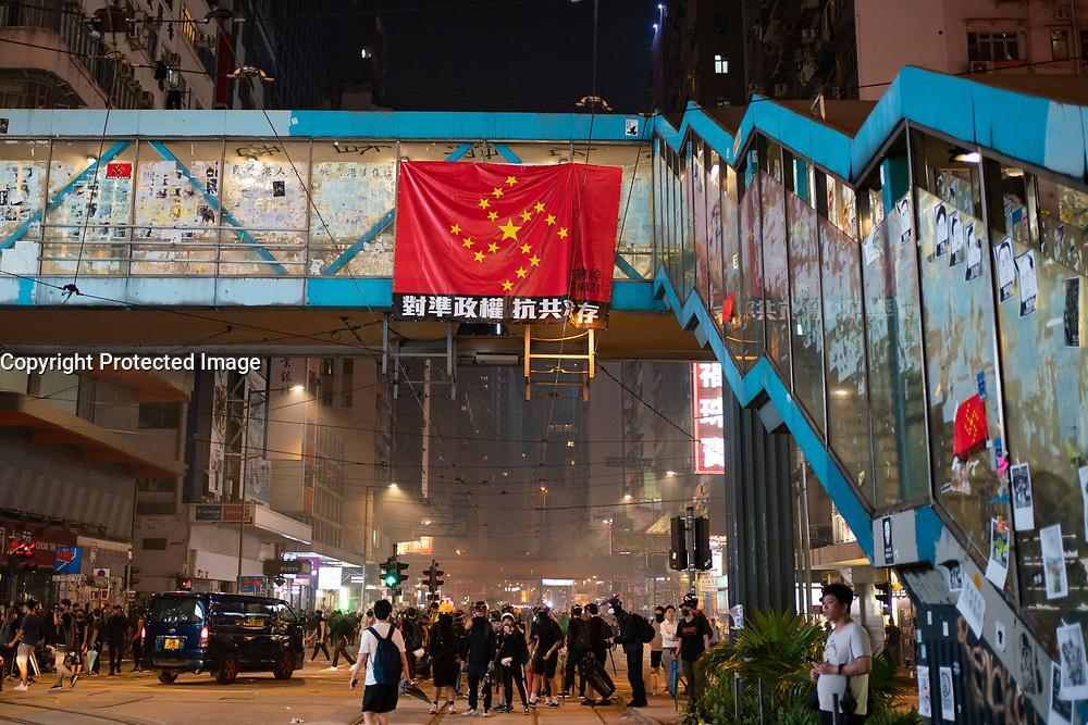 Hong Kong. 7 October 2019. Pro democracy demonstration in Hong Kong. Violent clashes between police and protestors. Property with Pr0-Beijing links vandalised.